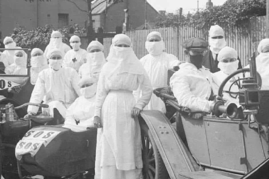 A history of pandemic, a team of doctors and nurses in 1919 pose with quarantine masks on outside Parramatta.