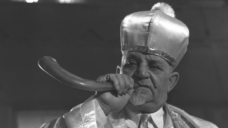 "A ""Shamash"" (sexton) blowing the shofar before Yom Kippur at the Ohel Moed Sephardi Synagogue in Tel Aviv, 1960."